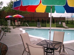 Pool With Umbrealla Tables La Quintainn & Suites Louisville 18 of 18