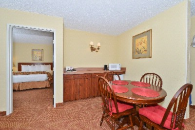 Make Yourself At Home In Our Suite Featuring A Living/dining Area And Separate King Bedroom. 17 of 18