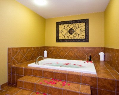 King Jacuzzi Suite With Two Person Whirlpool Tub 4 of 9