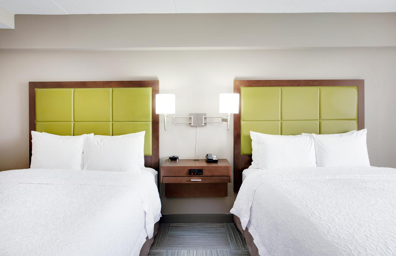 Our Double Queen Rooms Are Spacious For Your Comfort. 5 of 10