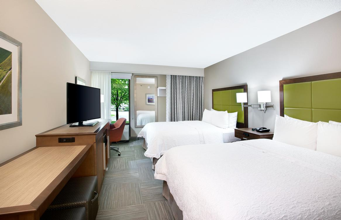 Our Double Queen Rooms Are Spacious For Your Comfort. 6 of 10