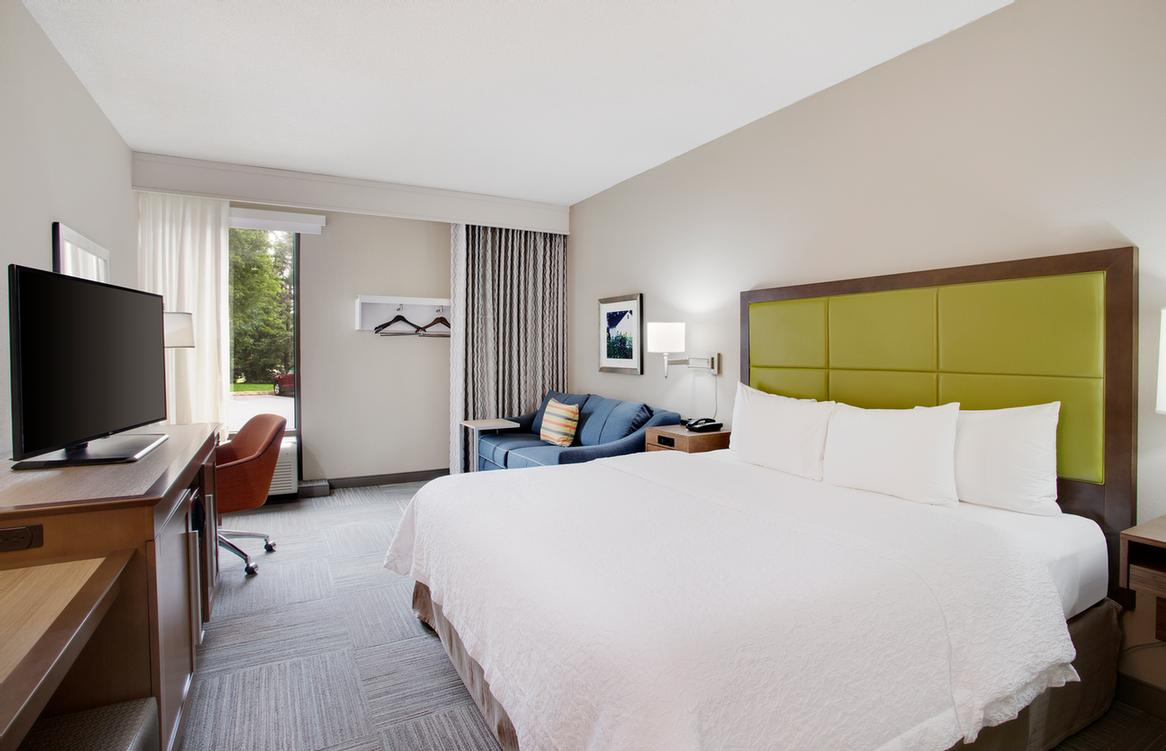 Traveling Alone For Business? Book A Room With A Plush King-Sized Bed So You Can Stretch Out And Relax! 7 of 10