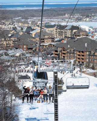 The Blue Mountain Resort Village Chairlift With Village In Background 8 of 9