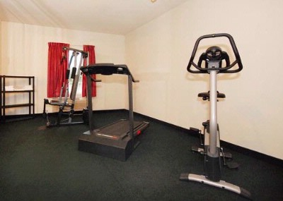 Fitness Center With Cardio Equipment And Weights 11 of 13