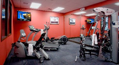 Fitness Room Located Next To Swimming Pool 10 of 16