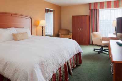 Our Modern And Spacious Guest Rooms Feature Our Signature Clean And Fresh Hampton Bed™ As Well As Flat Screen Television Spacious Work Desk Free Internet Access Easy To Set Alarm Clock Radio In-Room Coffee Service Waterpik® Showerhead Fluffy To 13 of 13