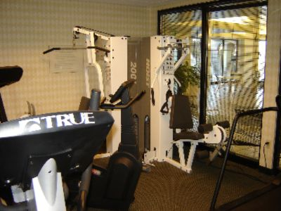 Fitness Center With Treadmills Eliptical Weight Machine And Stationary Bicycle. 8 of 12