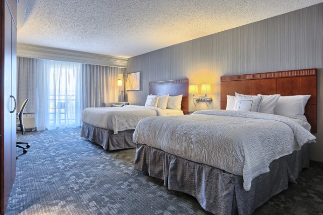 This Room With 2-Queen Beds Accommodates 4 People 6 of 11