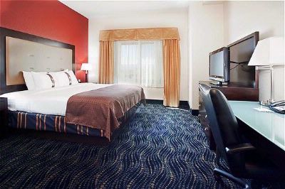 The Large Rooms At The Holiday Inn & Suites Grand Junction Help You Relax While Traveling. 5 of 9