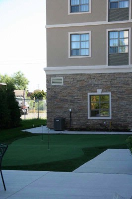 Practice Your Golf Swing On Our Outdoor Putting Green. 4 of 7