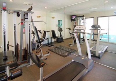 Exercise Room With Cardio Equipment And Weights 13 of 13