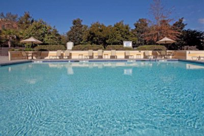 Large Seasonal Outdoor Pool Offering A Sun Deck. 8 of 11
