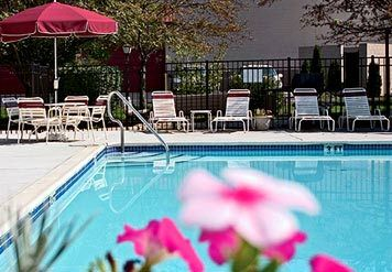 Ease Into The Personal Luxury Of Our Outdoor Pool 8 of 11