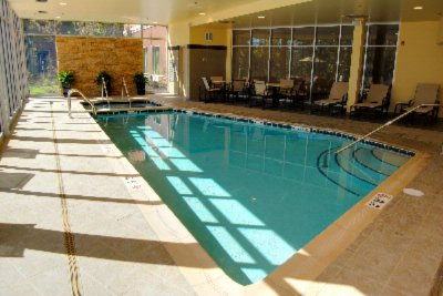 Indoor Pool & Spa Area Showing Fitness Area 6 of 31