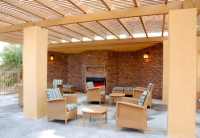 Our Poolside Fireplace Can Also Be Enjoyed 24 Hours Daily By Guests 3 of 10