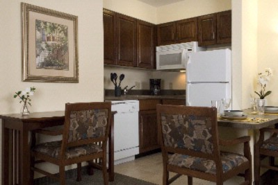 Each Suite Offers A Fully Equipped Kitchen. 4 of 9