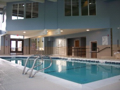 Indoor Pool With Fitness Center Above 4 of 9