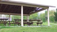 Picnic Area With Large Pool Grills Basketball Goal & Shuffle Board 6 of 13