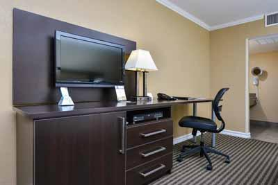 Beautifully Decorated Non-Smoking Rooms With 2 Posturepedic Pillow Top Queen Size Beds 32-Inch Lcd Tv With Dvd Player Work Desk Wired/wireless Internet Refrigerator And Lighted Vanity Mirror 4 of 31