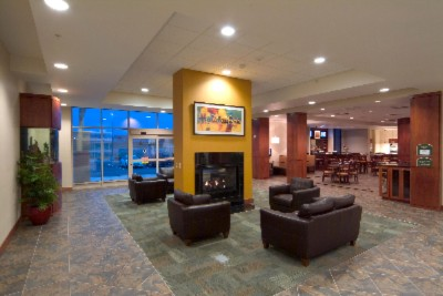 Inviting Lobby With 2 Sided Fireplace And Exotic Aquarium. 4 of 10