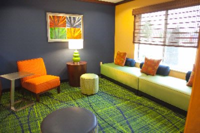 Sit Back And Enjoy The Bright Energetic Décor In Our Lobby Sitting Area. 3 of 15