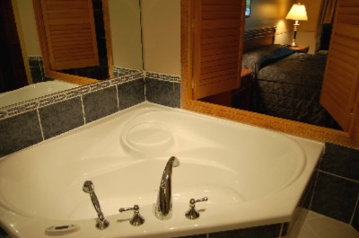 Newly Built In June 2006 Enjoy One Of Our Sensual Suites To Truly Add To Your Tranquil Getaway. This Suite Features A Large Shower Head And Two-Person Therapeutic Whirlpool In The Bathroom That Overlooks The Romantic Guest Room Setting. 6 of 11