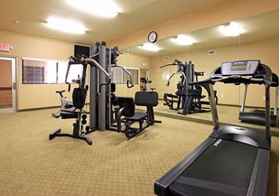 Exercise Room With Cardio Equipment And Weights 15 of 16