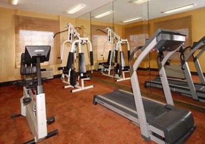 Fitness Center With Cardio Equipment And Weights 18 of 19