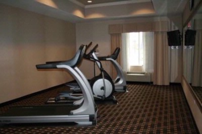 Fitness Center With 2 Treadmills And An Elliptical Machine. 12 of 21