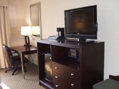 Flat Panel Televisions Are Featured In All Rooms. 5 of 21