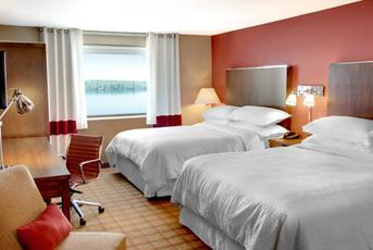River View Guest Room With 2 Queen Sized Beds 3 of 7