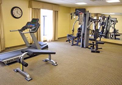 Fitness Center With Cardio Equipment And Weights 15 of 23