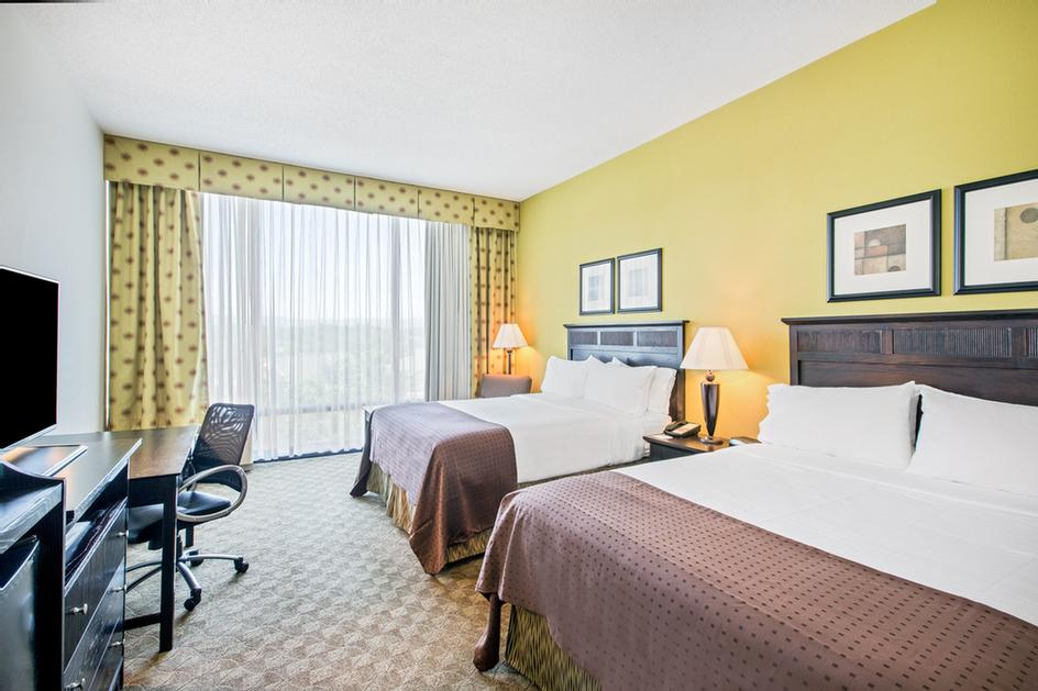 Our Spacious Rooms Are Designed To Be Your Home Away From Home Two Queen Beds Or One King Bed With Refrigerator Keurig Coffee Makers Microwaves Hair Dryer Iron/ironing Board 4 of 8