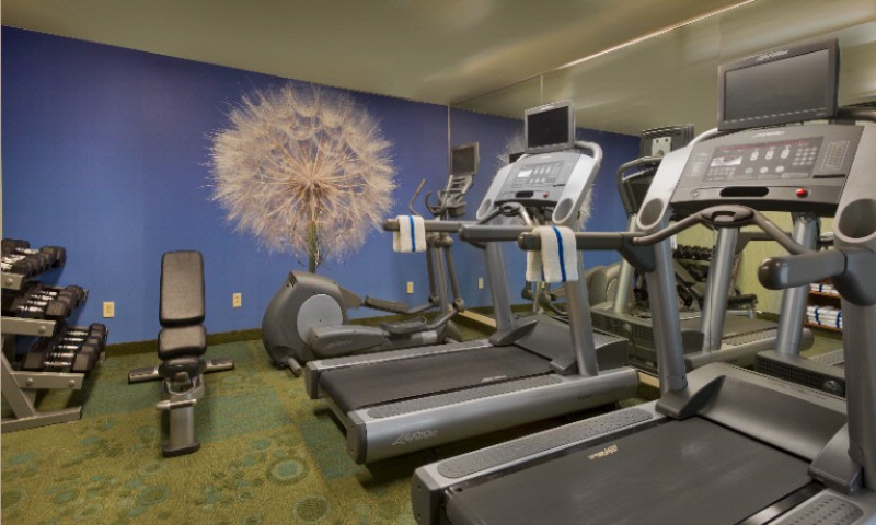 Maintain Your Healthy Lifestyle & Visit Our On-Site Fitness Center -Complete With Cardio Machines & Free Weights 6 of 8