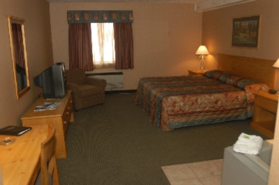 For An Extended Visit Or A Special Evening Enjoy A Stay In Our Hotel Suites. Pictured Here Is A King Suite From Kewadin Sault's Hotel. These Rooms Offer A Separate Bedroom Area Living Room Area Kitchenette And Whirlpool. 4 of 4