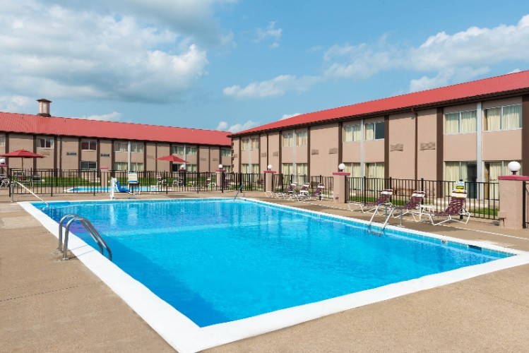 Soak Up The Sun And Cool Off On Those Hot Summer Days Next To Our Large Outdoor Pool 8 of 12