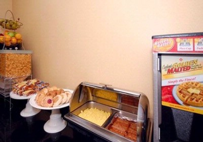 Full Buffet Style Breakfast Including: Eggs Meat 2 Flavors Of Waffles Yogurt Danish Doughnuts Hot/cold Cereal And Many Other Items. 15 of 16