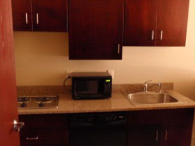 Extended Stay Suites With Kitchenette Living Center & Private King Room 9 of 13