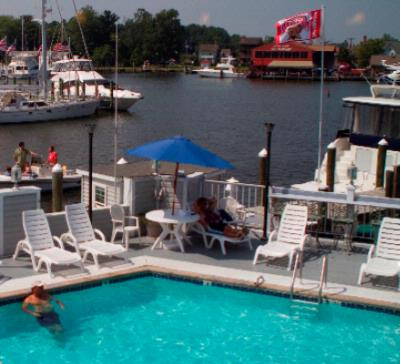 Enjoy Our Outdoor Pool Right On The Harborside 4 of 11
