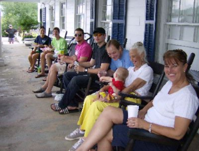 Folks Enjoying The Front Porch Rockers 5 of 19