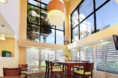 Best Western Cocoa Beach Hotel & Suites-Communal Table In Lobby 7 of 15