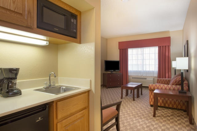 Our Executive Suites Offer More Space & A Living Room 5 of 19