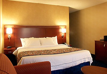 Our King Guest Room Features The Comfort Of Marriott Luxury Bedding In-room Coffee And Tea Iron Ironing Board Hairdryer And Loveseat. 6 of 10