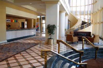 Two-Story Windows Unveil The Hotel\'s Spacious Lobby And Signature Grand Staircase. 4 of 9