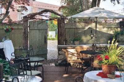 Outside Dining In The Sturbridge Area Is Complete With A Fireplace Lit Every Evening - So Bring Friends And Enjoy A Beverage Under The Stars Or A Warm Spring Day In The Sunshine Surrounded By Flowers. 5 of 11
