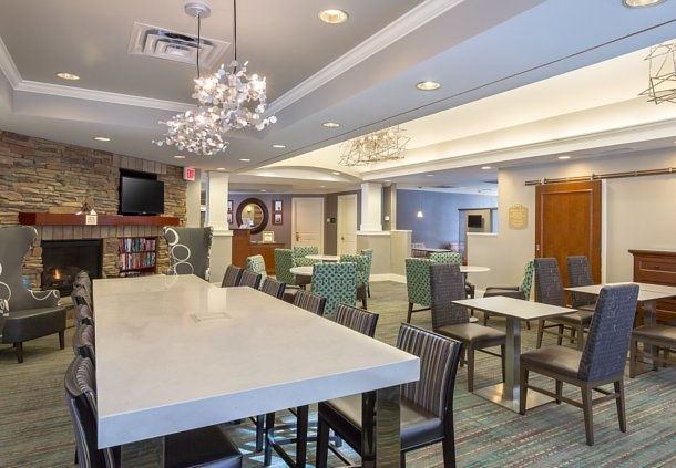 Get Work Done In Our Lobby Designed For Productivity With Free Wi-Fi And Communal Seating With Built-In Electrical Outlets. 8 of 11