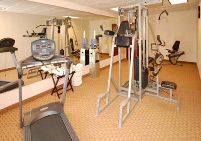 Exercise Room With Cardio Equipment And Weights 15 of 18