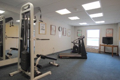 Fitness Area With Cardio Equipment And Weights 8 of 18