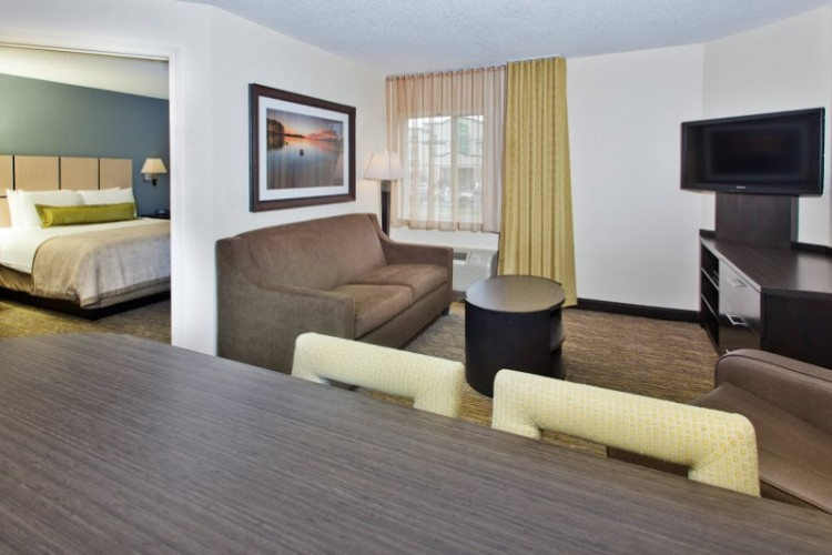 One Bedroom Suite With Queen Bed And Sleeper Sofa In Living Room 5 of 11