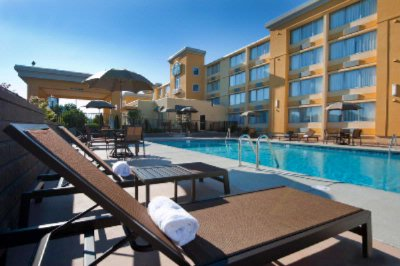 Lounge By Our Large Outdoor Pool 3 of 26